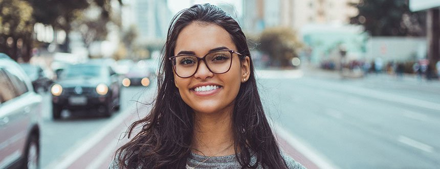 Girl in spectacles smiling